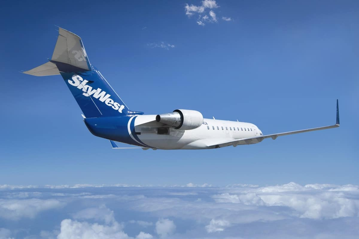 A SkyWest jet flying among the clouds