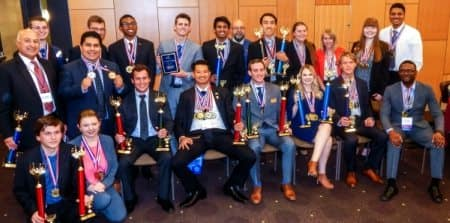 Prescott's Student Business Club pose with their trophies and awards after winning the PBL Arizona Leadership Competition for 12 straight years