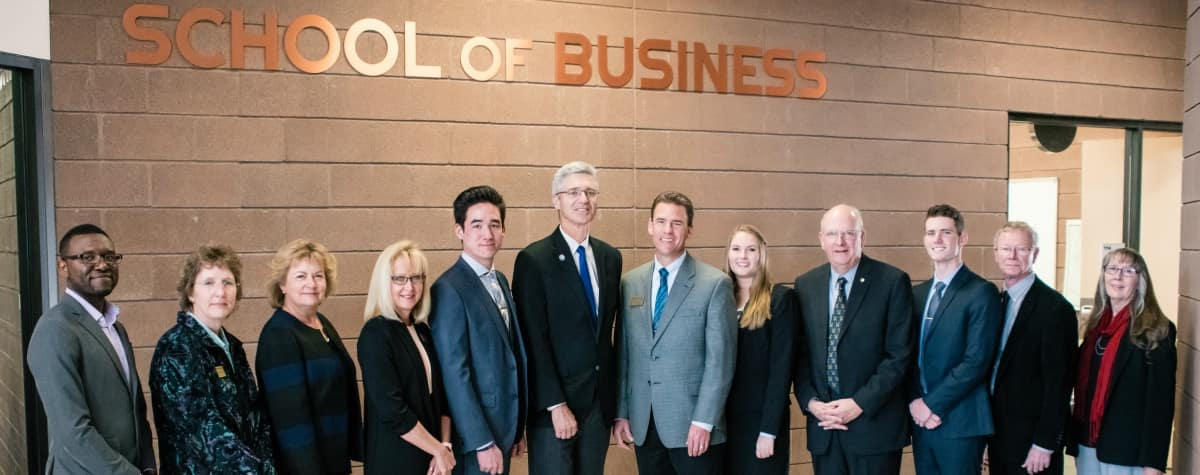 School of Business faculty and staff stand alongside the founder of the School of Business, Robin Sobotta; the Dean of the College of Arts and Sciences, Kathleen Lustyk; Embry-Riddle Aeronautical University President P. Barry Butler; Interim Chair of the School of Business Thomas Drape; and Chancellor of the Prescott Campus Frank Ayers