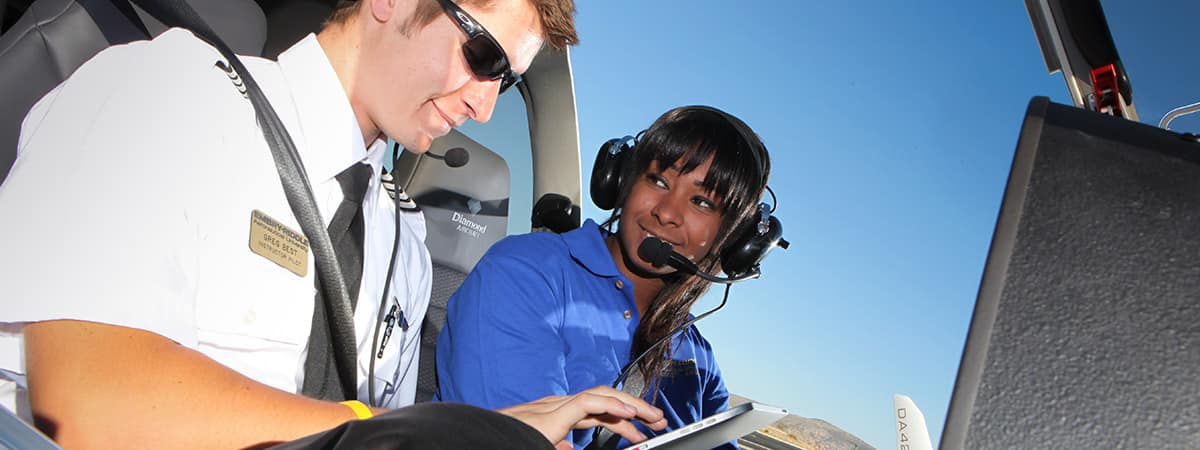 Embry-Riddle Flight Instructor and Student to a pre-flight check.