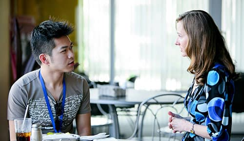 An admissions counselor provides advice and guidance to a student
