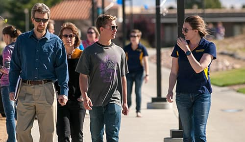 A student leads a prospective student and their family on a tour around Embry-Riddle Aeronautical University's Prescott Campus