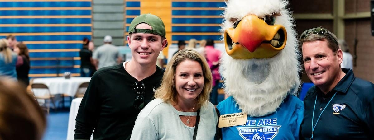 A student and their family meets Ernie the Eagle