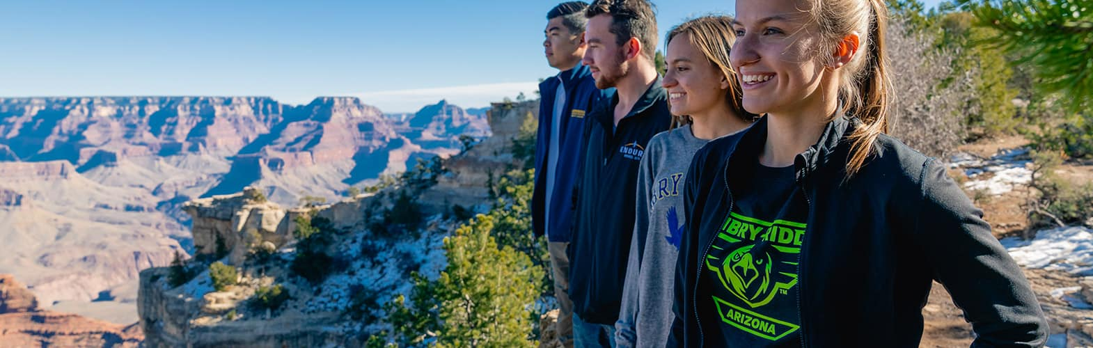 four smiling Enbry-Riddle Prescott students looking at mountains