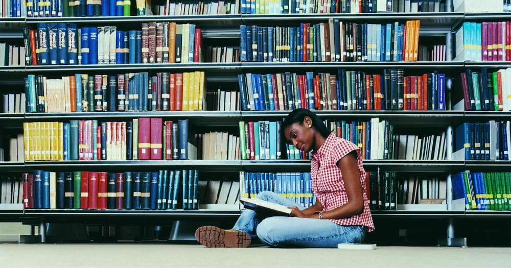 student reading in a library