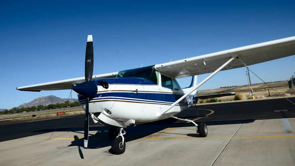 Close up image of the front of a Cessna 182 Skylane aircraft on the Prescott campus Flightline