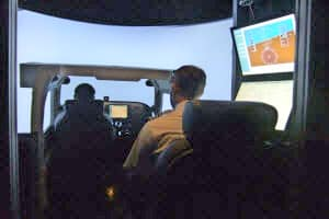 A student practices his flying in the Paradigm Cessna 172 AATD Simulator at Embry-Riddle's Prescott campus