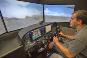 A student tests his skills in a Paradigm Diamond DA42NG AATD flight simulator at Embry-Riddle's Prescott campus