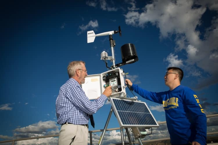 An instructor demonstrates how to operate one of the automated weather observing stations on campus