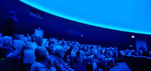 Visitors fill the Planetarium theater in anticipation of a new full dome planetarium show